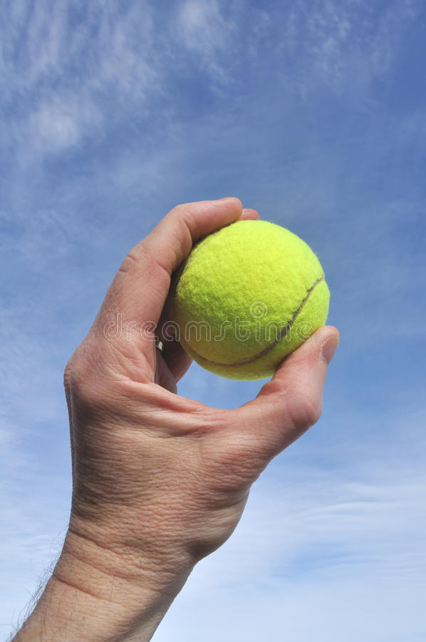 Download Player Gripping A Yellow Tennis Ball Stock Photo - Image: 13756338
