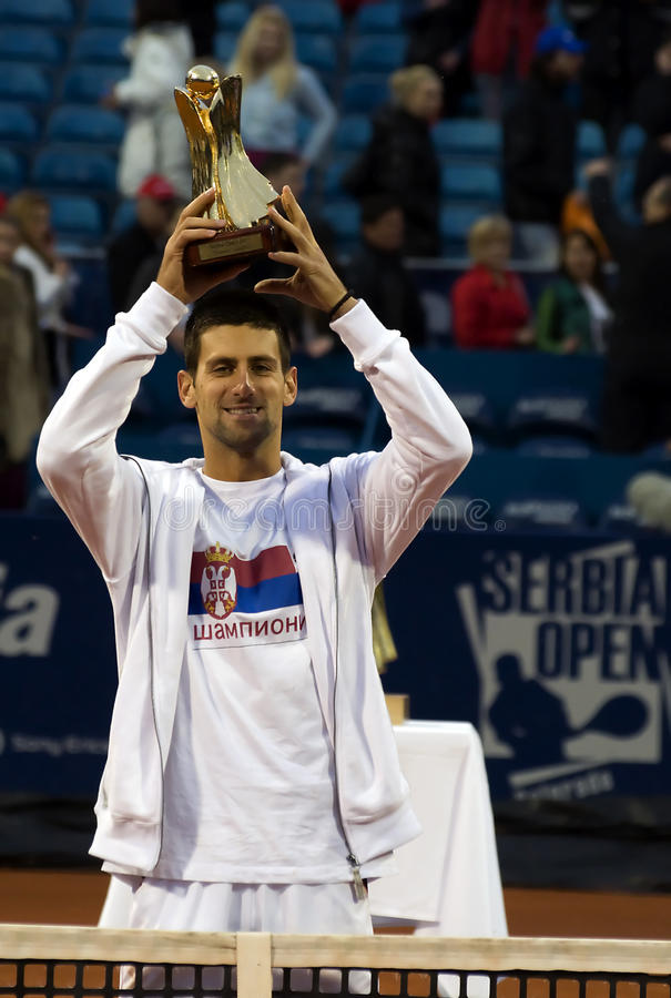 Player Novak Djokovic with championship trophy. BELGRADE-MAY 1:Seriba Open 2011.Final match:Novak Djokovic(SRB) vs Feliciano Lopez(ESP),Player N.Djokovic with stock photos