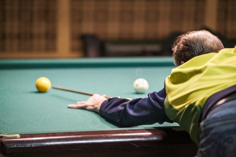 The player takes aim at the ball in Billiards stock image