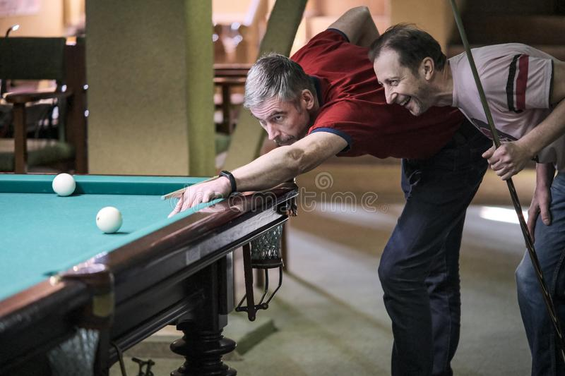 The player takes aim at the ball in Billiards royalty free stock photography