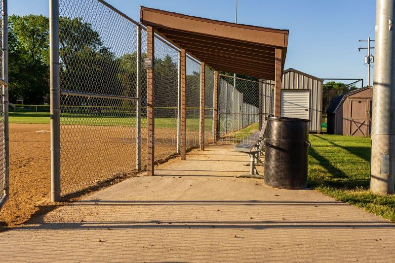 Players bench at a municipal softball field. A players bench at a municipal softball field stock image