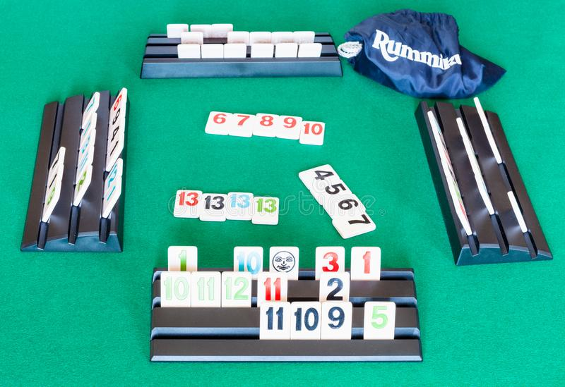 Playfield of Rummikub tile-based game on table. MOSCOW, RUSSIA - APRIL 3, 2019: playfield of Rummikub tile-based game on green baize table. Rummikub was invented royalty free stock images