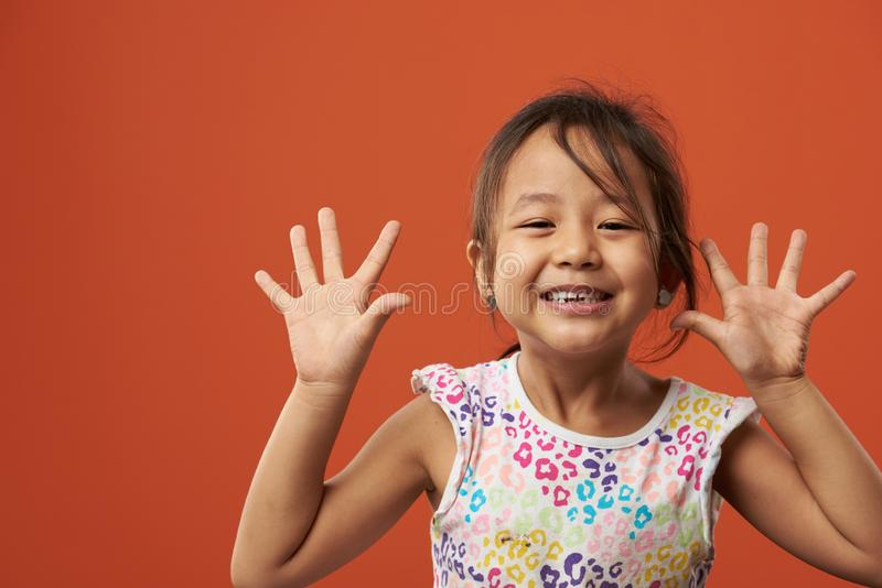 Playful asian girl portrait royalty free stock photography