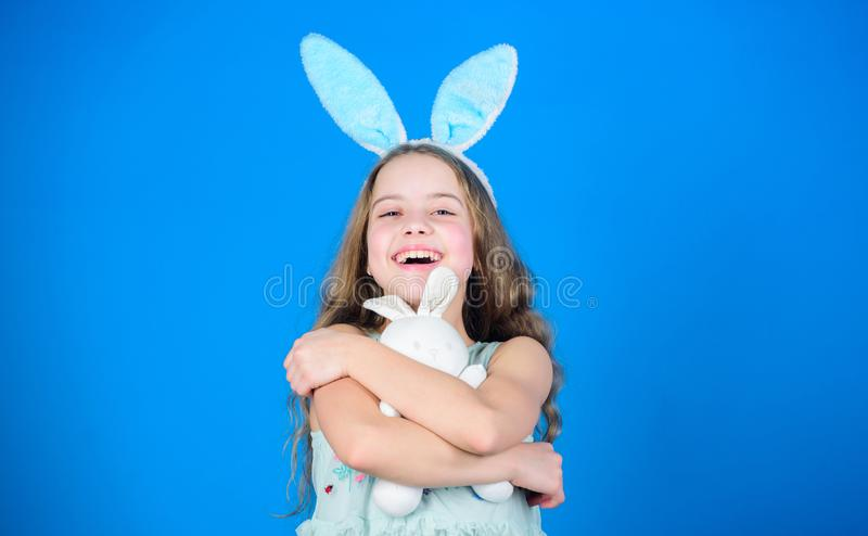Playful baby celebrate easter. Spring holiday. Happy childhood. Happy easter. Ready for Easter day. Easter activities. For children. Holiday bunny girl with royalty free stock images