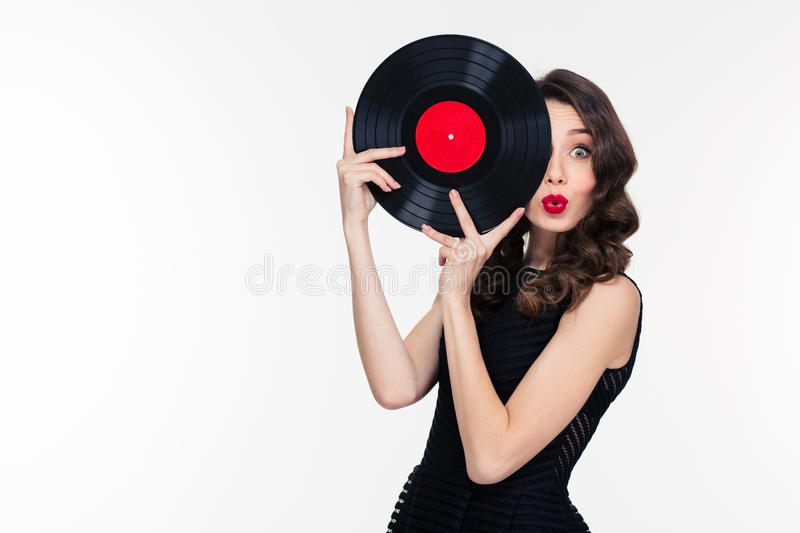 Playful beautiful woman covered half of face with vinyl disc stock images