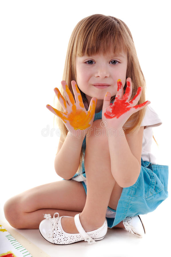 Playful beauty girl with many-coloured hands stock photo