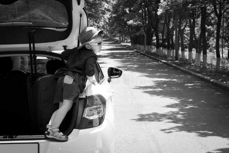 Download Playful Boy Standing In The Open Truck Of A Car Stock Image - Image: 31333881