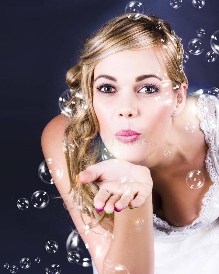 Download Playful Bride Blowing Bubbles At Wedding Reception Stock Image