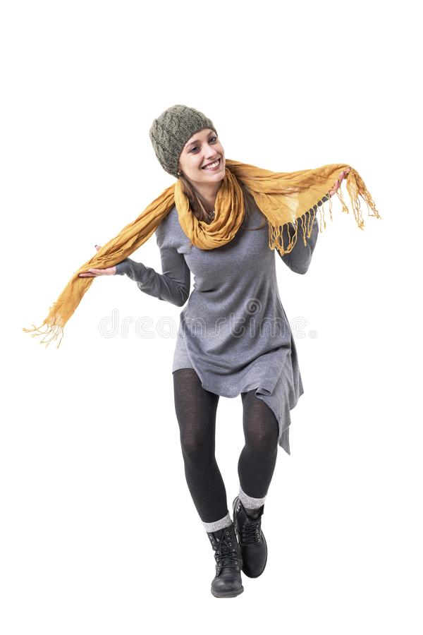 Playful cheerful young stylish woman bowing in respect smiling and holding scarf. Full body isolated on white background stock photo