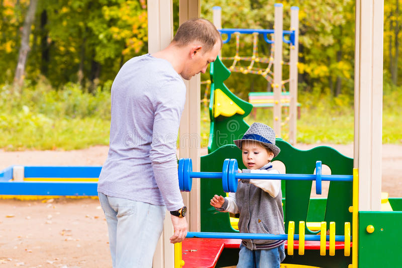Playful child with father at the playground outdoor. stock image