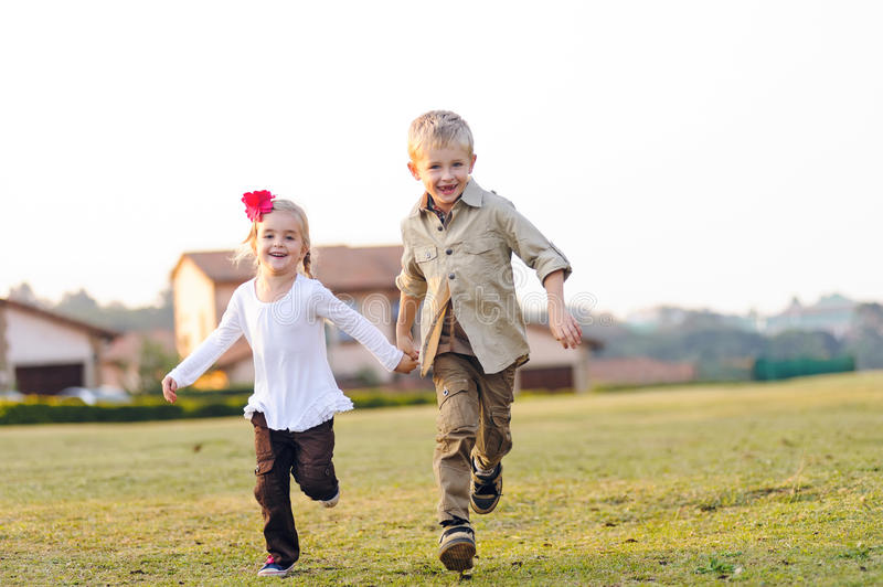 Playful childhood siblings royalty free stock photography