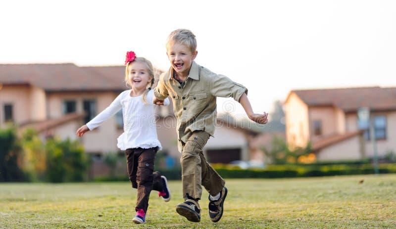 Playful childhood siblings stock photo