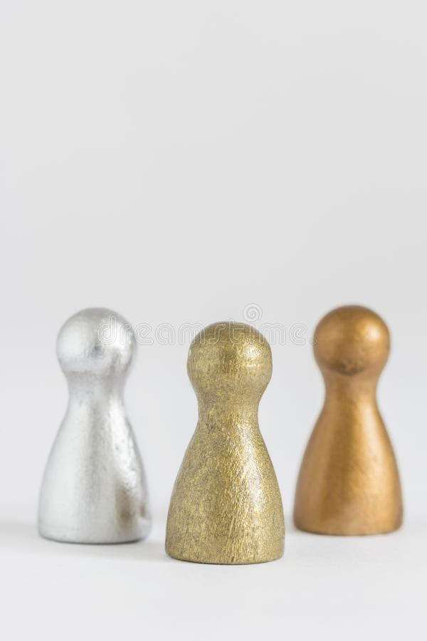 Gold, silver and bronze gamefigurine royalty free stock photo