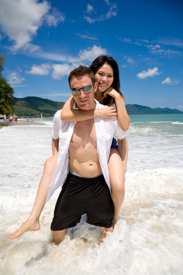 Download Playful Couple At The Beach Stock Photo - Image: 5136670