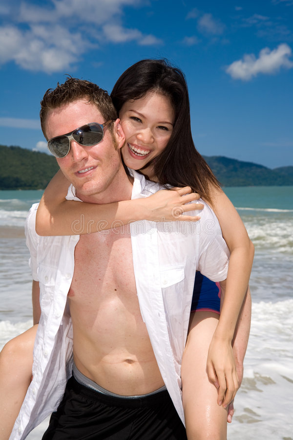 Playful Couple At The Beach Stock Photography
