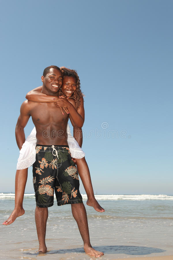 Playful Couple on the Beach in the Ocean Water royalty free stock images