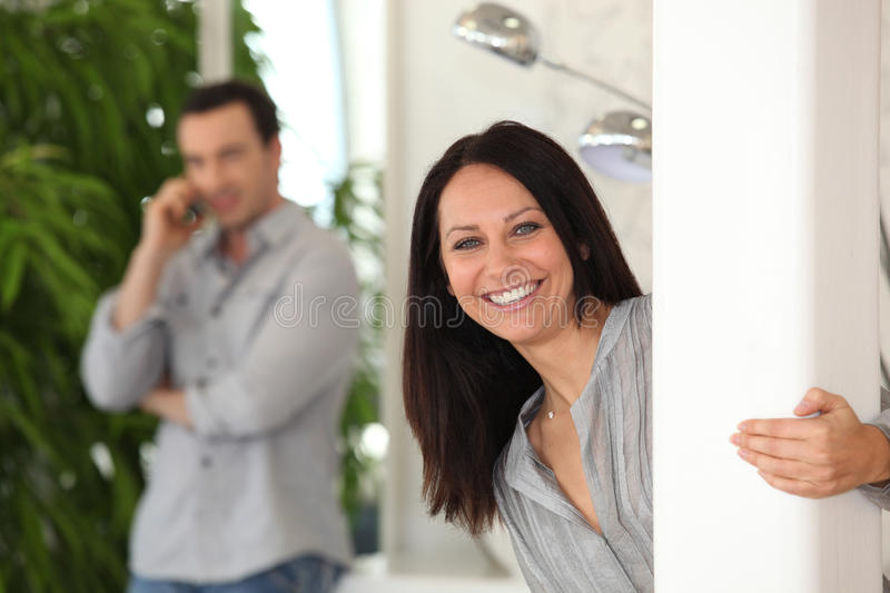 Playful couple at home stock images