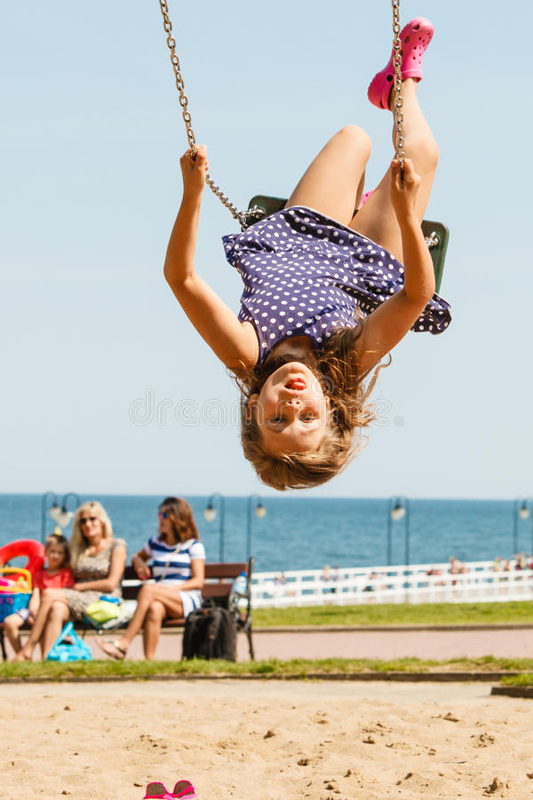 Playful crazy girl on swing. royalty free stock image