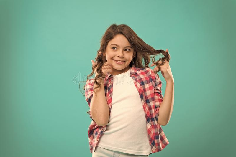 Playful curls. Beauty tips for tidy hair. Kid girl long healthy shiny hair wear casual clothes. Little girl with long stock photos