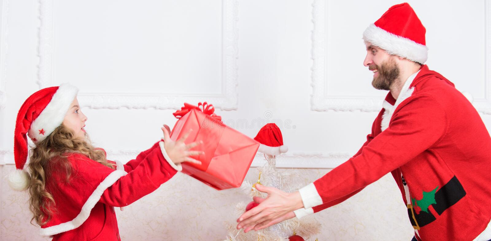 Playful daughter and dad celebrate christmas. Winter activity and fun. Child pretend to fight for christmas gifts stock photos