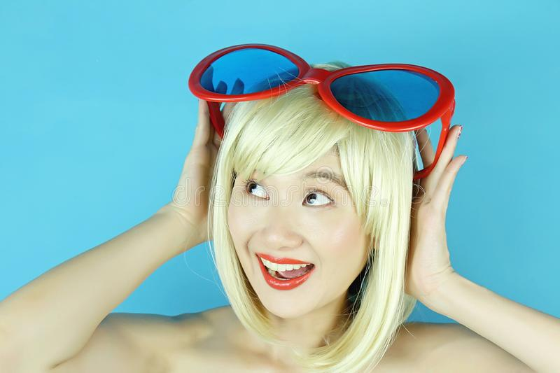 Playful girl with funny glasses, Happy naughty blonde hair woman. royalty free stock images