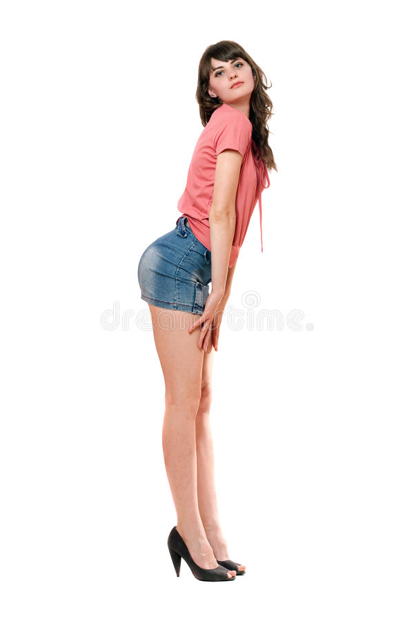 Playful girl in jeans mini skirt. Isolated royalty free stock photography