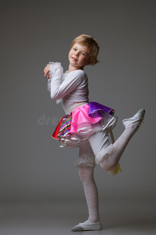 Playful little ballerina posing at camera stock photos