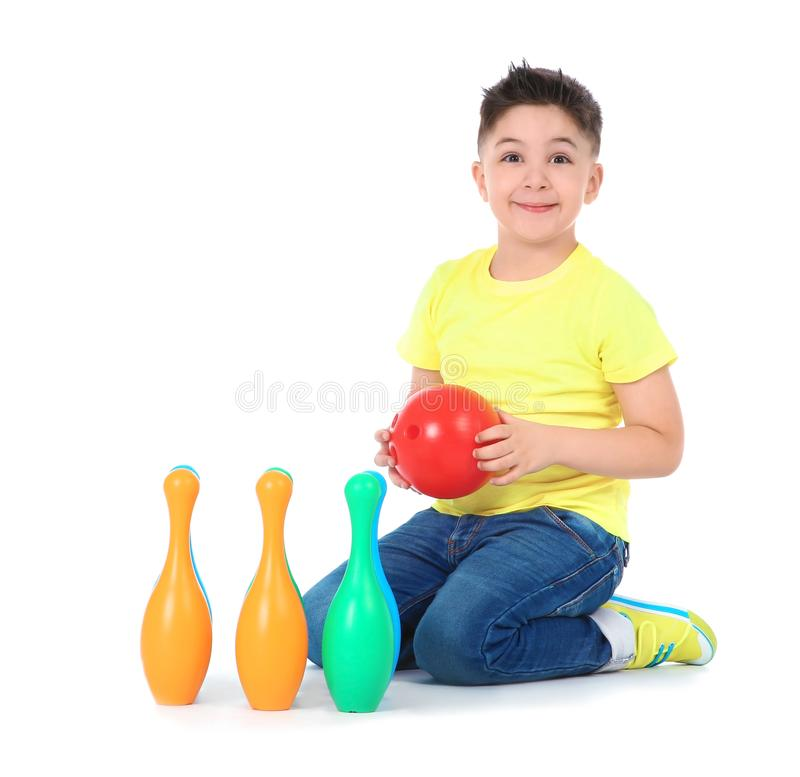 Playful little child with plastic bowling set. On white background. Indoor entertainment stock images