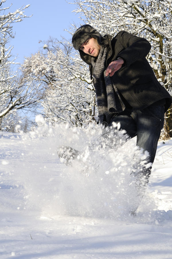 Playful man fighting with snow royalty free stock photo
