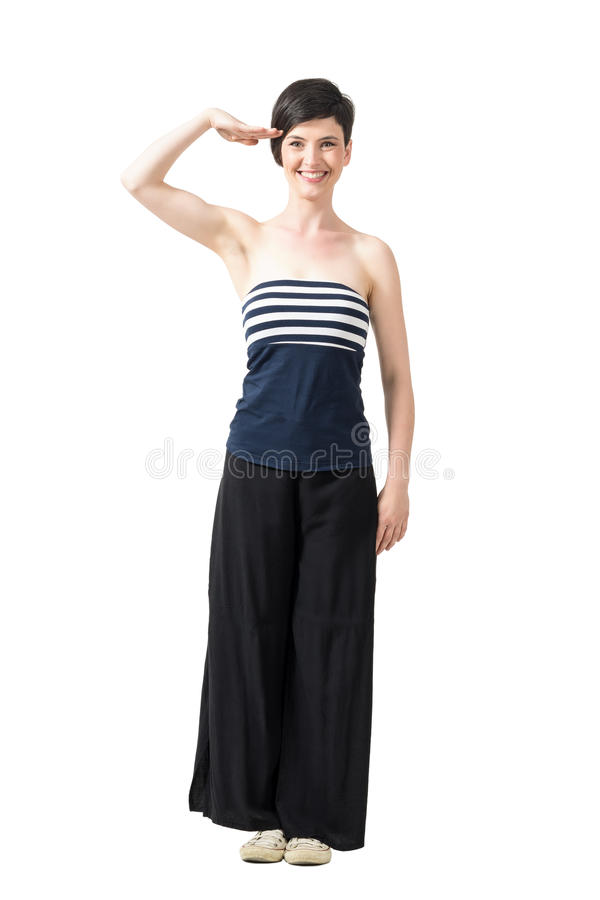 Playful pretty short hair trendy girl saluting and smiling at camera royalty free stock images