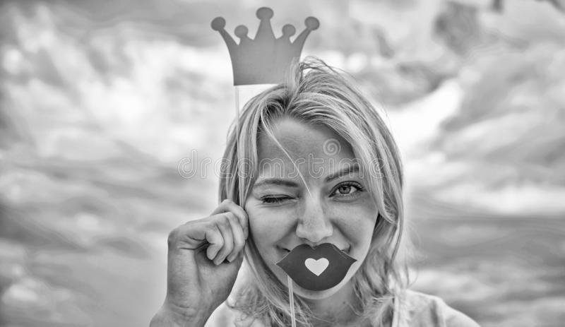 Playful princess. Woman blonde hair hold cardboard tiara or crown and red lips symbol of love sky background. Lady stock images