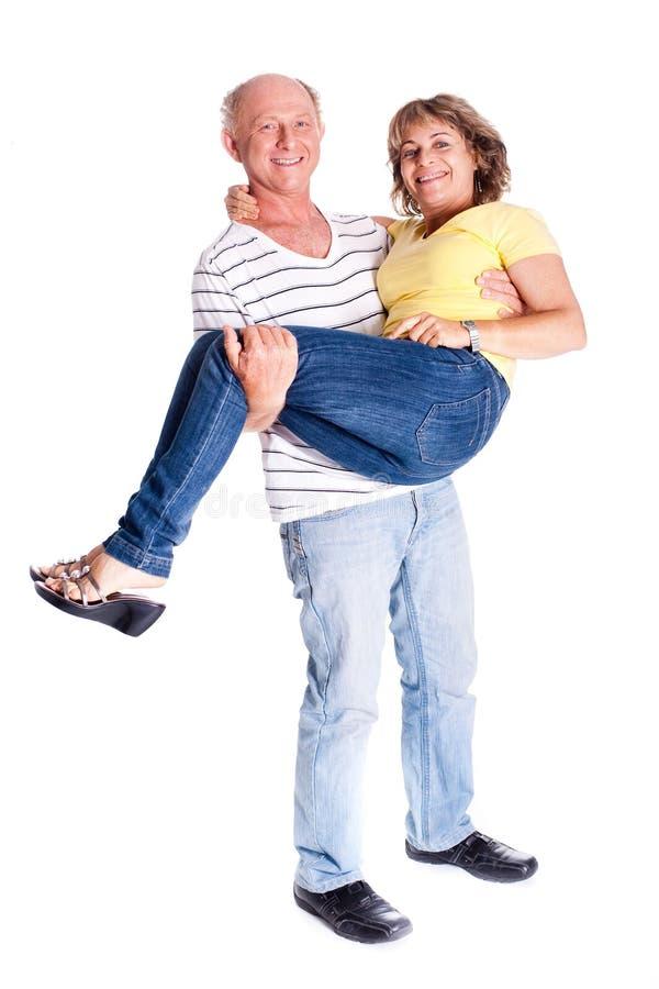 Download Playful Senior Couple Having Fun Indoors Stock Photo - Image: 20039352
