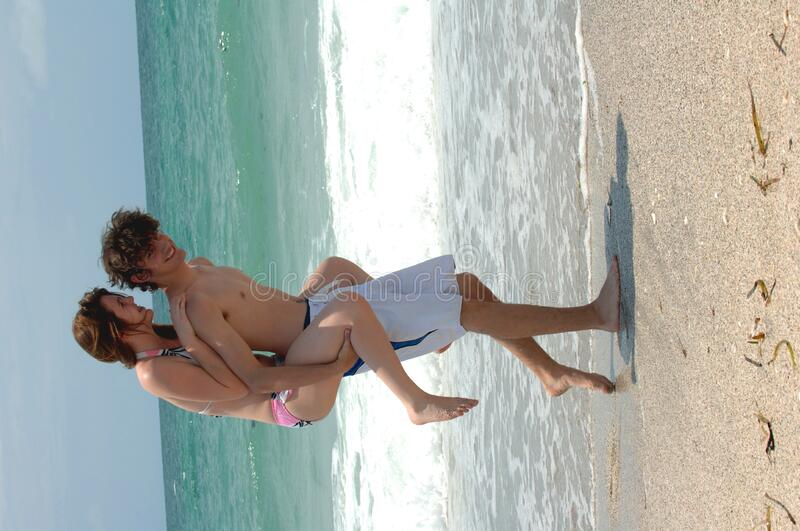 Download Playful young beach couple stock image. Image of goofing - 2990193