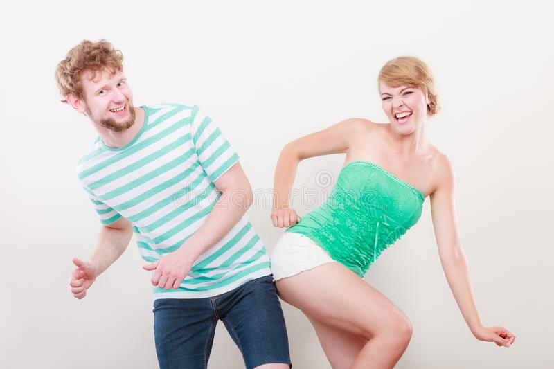 Playful young couple blonde girl bearded man stock photo