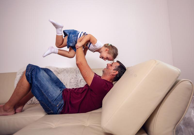 Playful young family - Smiling father and daughter having fun to royalty free stock photo