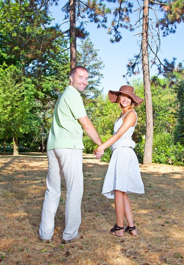 Playful young love couple having fun stock photos