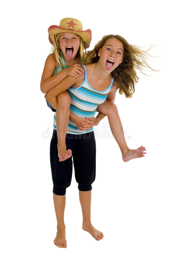Playful young naughty sisters having fun stock images