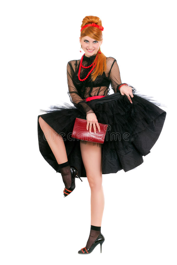 Playful young woman. In black dress. Isolated stock photography