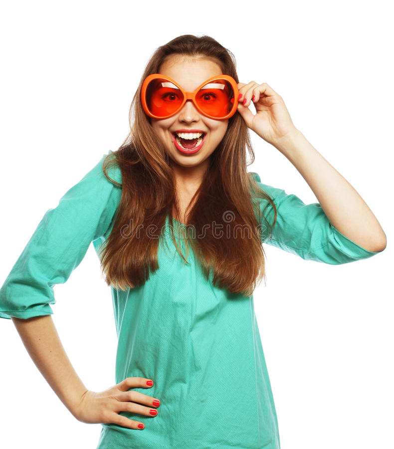 Playful young woman with party glasses. Ready for good time. stock image