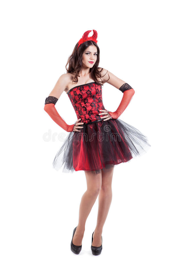Playful young woman is wearing a devil stock photo