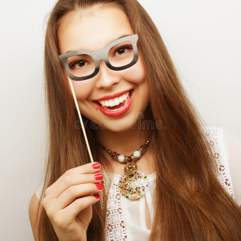 Playful young women holding a party glasses. stock photography