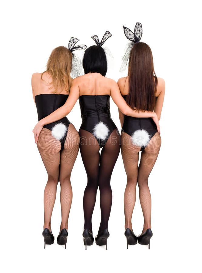 Playgirls sexy che portano i costumi di un coniglietto, vista posteriore immagini stock