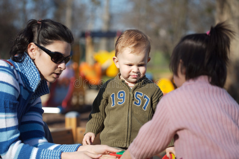 Download On the Playground stock photo. Image of happy, parenthood - 2611422