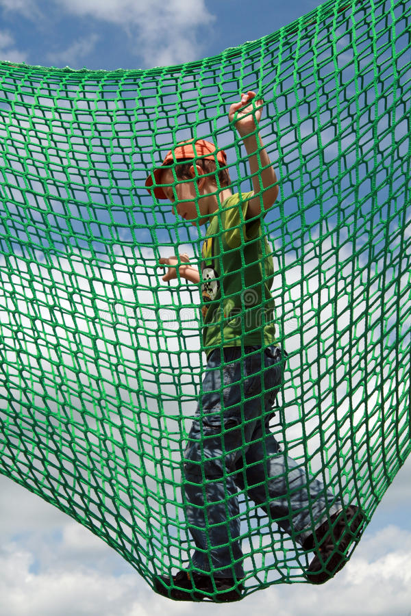Playground. Child on a playground. Five years old boy playing at a playground stock photography