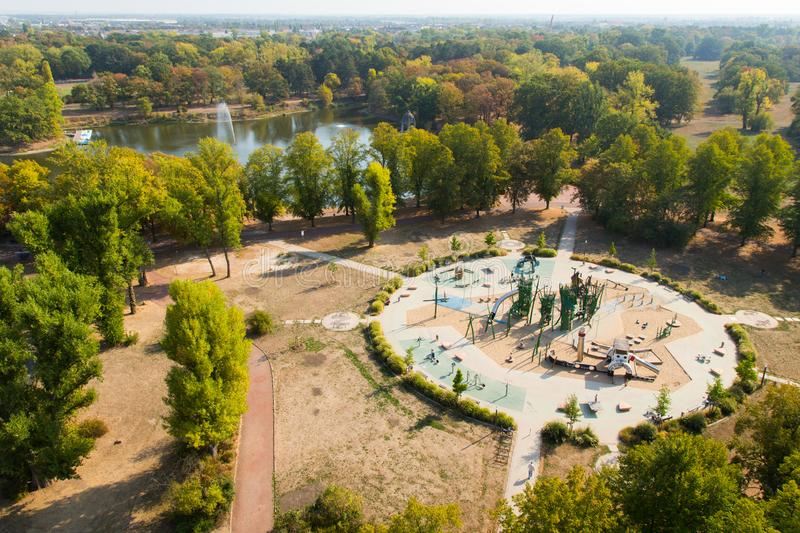 Playground and Adolf Mittag Lake in Rothehornpark in Magdeburg stock images