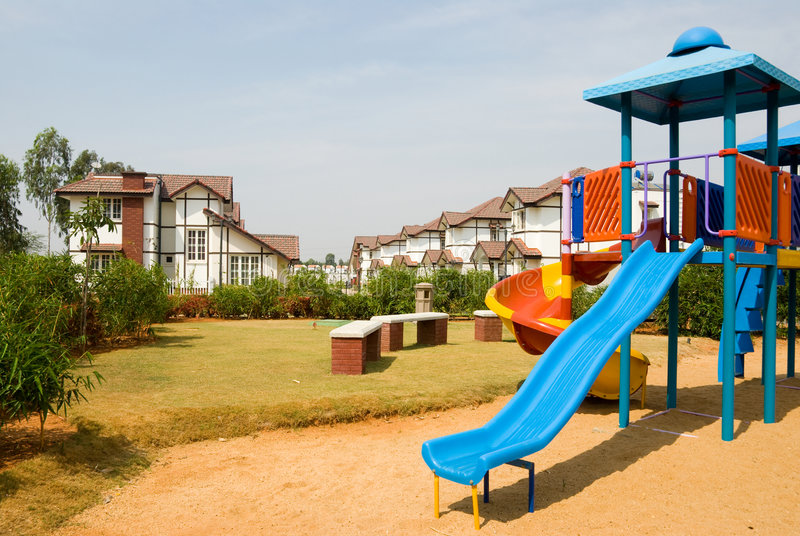 Playground amidst Tudor homes stock image