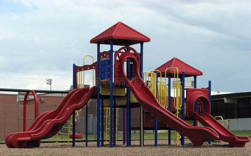 Playground Equipment. Contemporary playground equipment on school grounds stock photos
