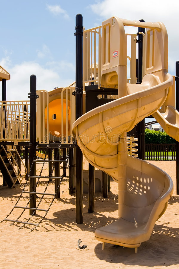 Playground Equipment. Children's playground equipment featuring a tower slide and chain ladder stock image