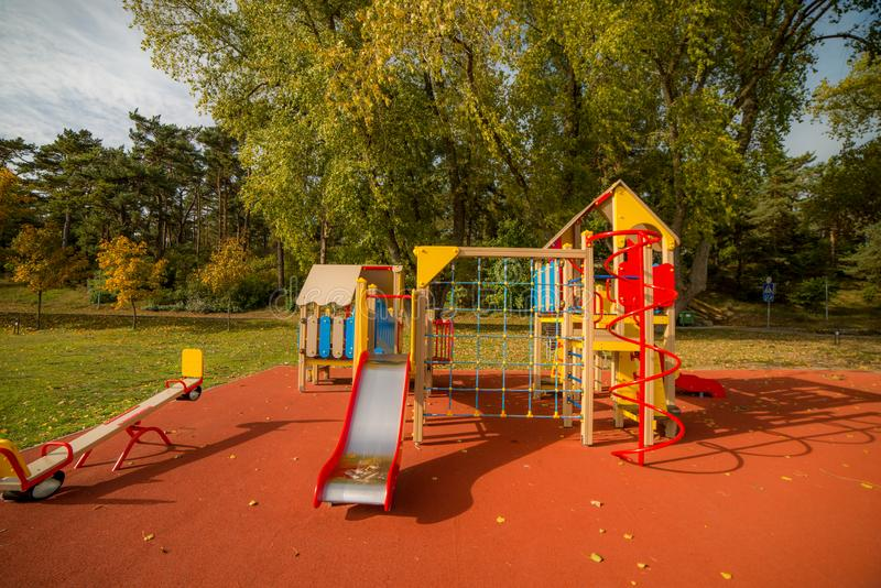 Playground equipment. A big colorful children playground equipment in fall season royalty free stock image