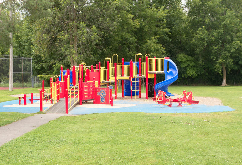 Playground equipment. A typical childrens playground with play equipment stock image